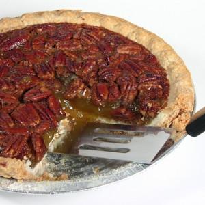Pecan pie filling is a baked mixture of sugar, eggs, vanilla, pecans ...