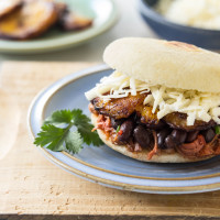 Arepa Filled with Shredded Beef, Black Beans, Fried Plantain & White Cheese
