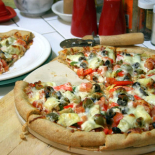 Pizza with Red & Green Peppers, Onions, Artichoke Hearts, and Olives