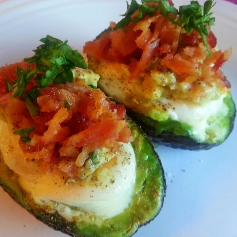 Baked Eggs in Avocado with Guacamole, Parmesan Cheese, and Bacon