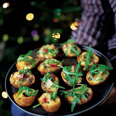 Baked potato skins with gorgonzola, rocket and mustard fruit
