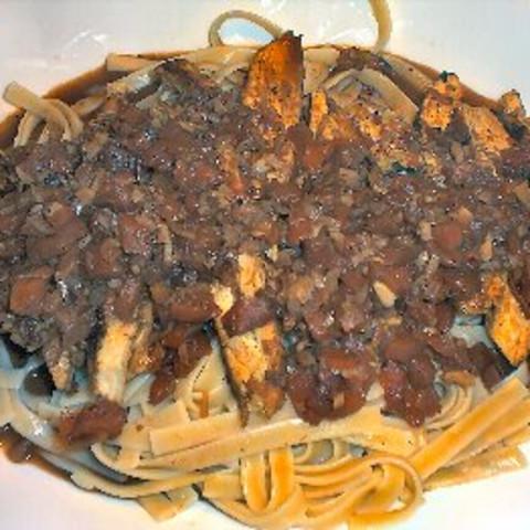 Blackened Chicken Strips on Pasta W/cajun Sauce