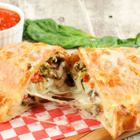 Calzone with Broccoli, Red Peppers, and Mushroomswith marinara dipping sauc