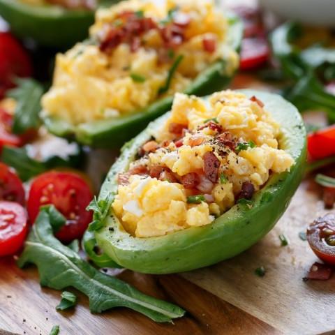 Cheesy Scrambled Eggs in Avocado with Bacon Pieces