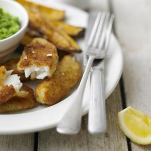 Lemon sole goujons with mushy peas and sweet potato chips