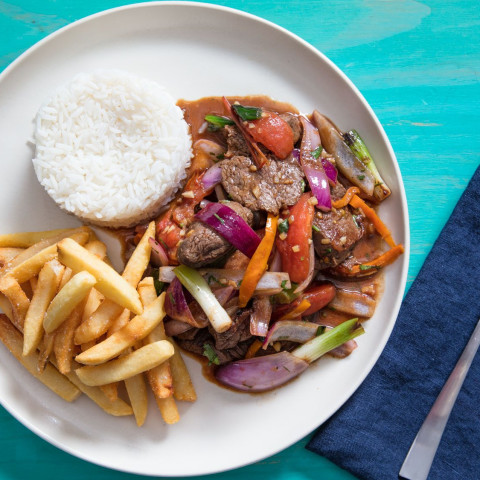 Lomo Saltado (Peruvian Stir-Fried Beef With Onion, Tomatoes, and French Fri
