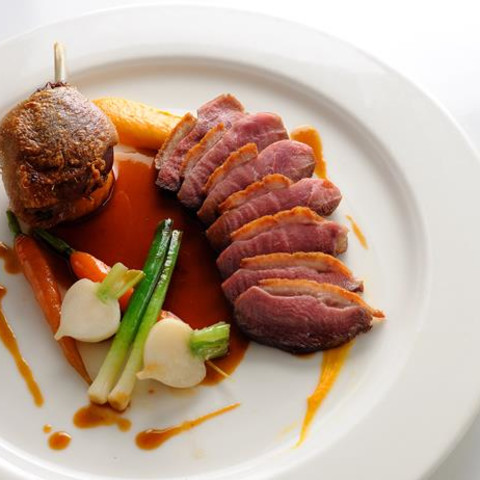 Pan-roast duck with sweet potato fondant, baby vegetables and cherry brandy