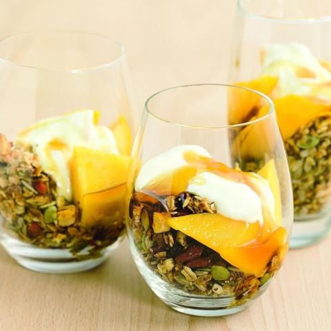 Toasted muesli, mango and yoghurt breakfast parfait