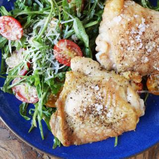 Baked Chicken Thighs with Arugula Caesar Salad