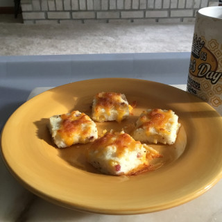 Breakfast Grit squares toasted in broiler
