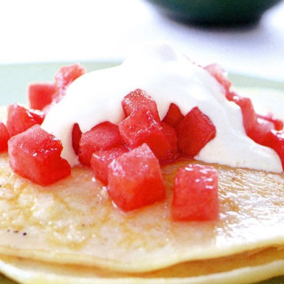 Coconut pancakes with watermelon in vanilla syrup