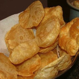 Deep-Fried Whole Wheat Breads with Cumin (Puri)