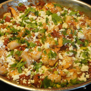 Flambéed Shrimp With Tomatoes, Feta Cheese, and Ouzo
