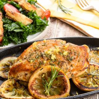 Lemon-Rosemary Roasted Chickenwith kale Caesar salad and crispy artichokes