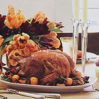 Roast Turkey with Apples, Onions, Fried Sage Leaves, and Apple Cider Gravy