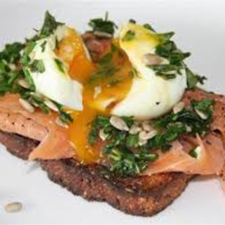 Soft-boiled egg with smoked trout and fresh herds