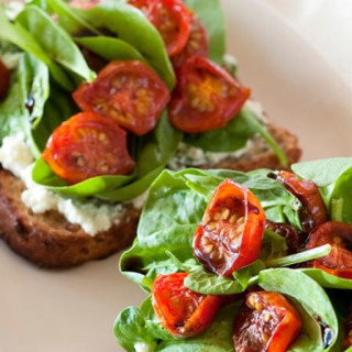 Spinach, tomato and basil ricotta toast