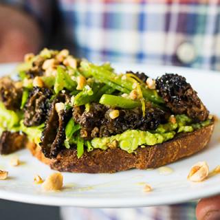 Warm Avocado Tartine with Morel Mushrooms and Pea Salad