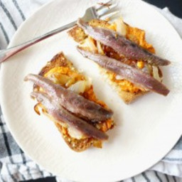 Anchovy Toast with Caramelized Onions and Pimiento Spread