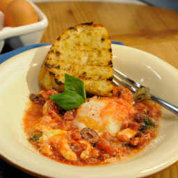 Baked Eggs with Salami, Mozzarella, Olives and Garlic Bread