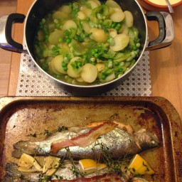 Baked whole trout, with jersey royals, peas and mustard sauce