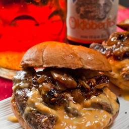 Bratwurst sandwich with beer braised onions and beer cheese sauce