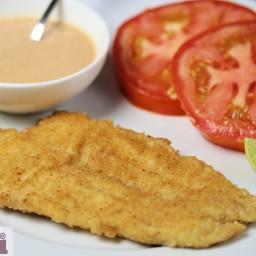 Breaded fish fillets with tomato-chipotle mayonnaise (Pescado empanizado co