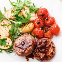 Caramelised onion rissoles with charred potato salad