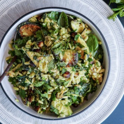 Charred zucchini, risoni and herb salad with parmesan and pea dressing