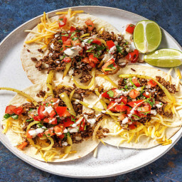 Cheesy Beef Tostadas with Green Pepper, Tomato Salsa, and Hot Sauce Crema