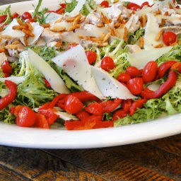 Chicken frisee salad with roasted peppers, manchego and Spanish paprika