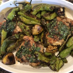 Chicken with basil anchovy butter and Shishito peppers