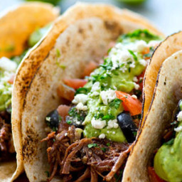 Chipotle Pulled Beef Tacos with Greek Salsa + Avocado Crema