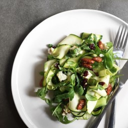 Courgette and rocket salad with candied almonds, feta and cranberries