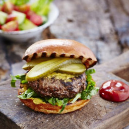 Elvis burger with chopped salad and pickled gherkin