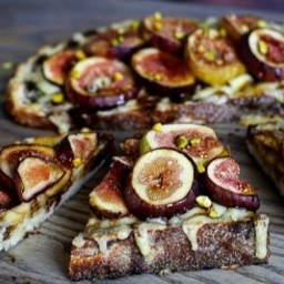 Fig and Gruyere Crostini with Bourbon Balsamic Glaze and Pistachios
