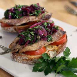 Fresh sardines on toast with sweet pickled red onion