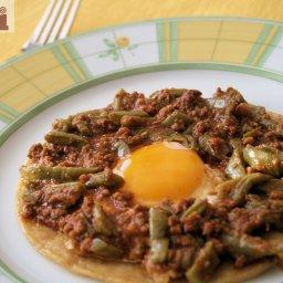 Fried eggs in chorizo and nopal cactus sauce  (Huevos estilo Neza)