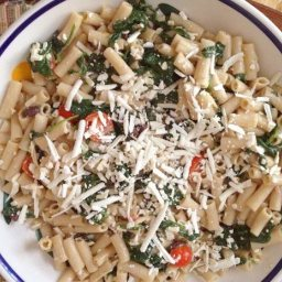 Gluten-Free Pasta with Ricotta Salata, Garlicky Spinach, Tomatoes and Olive