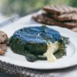 Grape Leaf-Wrapped Camembert with Pesto