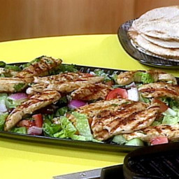 Greek Grilled Chicken and Vegetable Salad with Warm Pita Bread for Wrapping