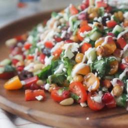 Healthy Crispy Chickpea Greek Salad with Pomegranates and Tzatziki Drizzle