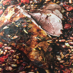 Lamb: slow cooked leg of lamb with beans and tomatoes