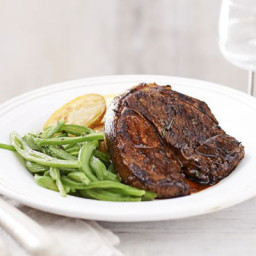 Lamb steaks with crispy potatoes and minted beans
