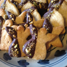 Lemon-cardamom cookies dipped in chocolate w/pistachio & salt sprinkles.