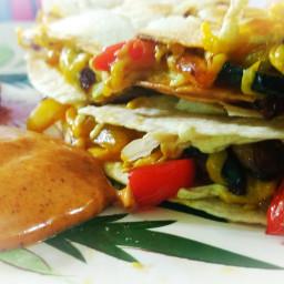 Loaded veggie vegan Quesadillas with smokey creamy chili sauce