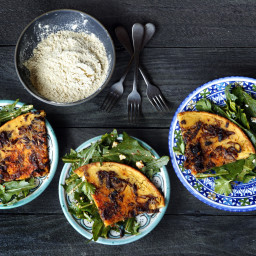 North African chickpea pancake with harissa-topped bitter greens