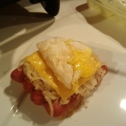 Open Faced Hot Dog w Sauerkraut and Cheese and Fried Eggs!