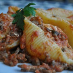 Pasta shells filled with ricotta and baked in a tomato meat sauce