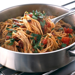 Pasta with anchovies, tomatoes, olives and garlic